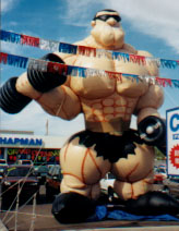 25 ft. Muscleman advertising inflatables for sale and rent.