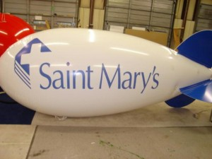 advertising blimp with Saint Mary's logo