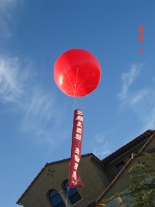 large balloon with vertical banner