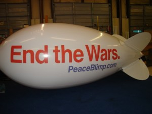 advertising blimp with lettering