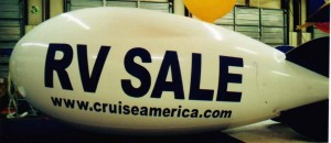 helium advertising blimp with lettering