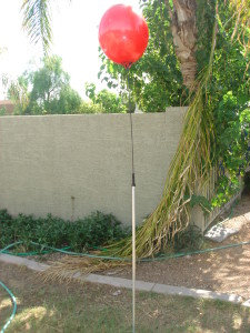 Reusable, permanent balloon on fiberglass rod.
