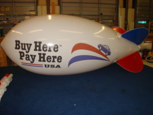 custom advertising blimps for car dealerships.